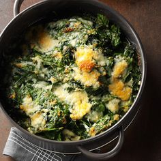 This quick side dish features fresh spinach with garlicky butter and Parmesan. | Spinach-Parm Casserole Recipe from Taste of Home