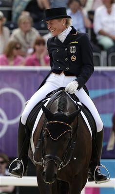 London Olympics Equestrian  July 28Germany's Ingrid Klimke reacts after riding Butts Abraxxas in the equestrian eventing competition at the 2012 London Olympics Saturday, July 28, 2012, at Greenwich Park in London. (AP Photo/Charlie Riedel)