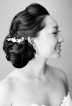 Brides.com: . Braided Updo with Flower Detail. The thick braids and flowers incorporated in this wedding hairstyle give it a boho, beach vibe, but the shape of it feels very retro. If you're looking for a statement updo, this is it.  Browse more wedding updos.