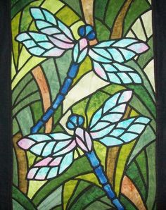 Dragonfly quilt that looks like stained glass.