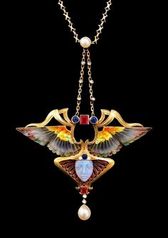 """Art Nouveau """"Nike"""" enamelled pendant set with rubies, sapphires, pearls and diamonds, by Philippe Wolfers."""
