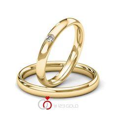 1 Paar Trauringe - Legierung: Gelbgold 585/- Breite: 3,00 - Höhe: 1,80 - Steinbesatz: 1 Brillant 0,05 ct. tw, si (Ring 1 mit Steinbesatz, Ring 2 Trauringe Steinbesatz)