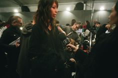 Issah Lish sharing her opinions with FashionTV backstage at Moschino by Jeremy Scott.