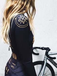 Photos of hot women with or on bicycles.