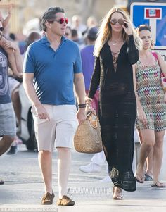 All loved-up: Elle and Jeffrey, a Miami real-estate developer, began their relationship in 2009, though split in March 2012 before rekindling their romance later that year