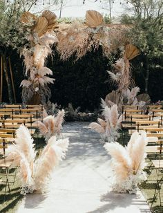 15 Whimsical Wedding Aisle Ideas with Pampas Grass - CoolTat.- 15 Whimsical Wedding Aisle Ideas with Pampas Grass – CoolTattoo 15 Whimsical Wedding Aisle Ideas with Pampas Grass – CoolTattoo - Lilac Wedding, Whimsical Wedding, Boho Wedding, Wedding Table, Floral Wedding, Wedding Ceremony, Wedding Flowers, Dream Wedding, Rustic Wedding