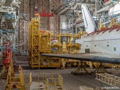 Abandoned hanger for USSR's Buran 'space shuttle'. This program was formally shut down in 1993 http://en.wikipedia.org/wiki/Buran_%28spacecraft%29 The location is the Baikonur Cosmodrome in Kazakhstan