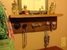 Barn wood and reproduction knob accessory shelf for my closet. Another Pinterest idea brought to life.