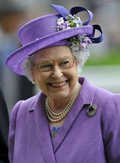 Ascot Day 3, 2013....Britain's Queen Elizabeth smiles as she looks at the horses in the parade ring during ladies' day at the Royal Ascot horse racing festival at Ascot, southern England, June 20, 2013. The Queen's horse, Estimate, won the Gold Cup event on Thursday.