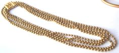 Vintage Metal multi-strand beaded necklace by JewelryStatements