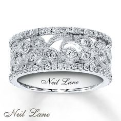 Jewelry designer Neil Lane creates contemporary designs with a nod to classic styling. In this vintage-inspired design, from the Neil Lane Designs® collection, leaves and vines sparkle with round brilliant diamonds totaling 3/4 carat. Additional round diamonds line the top and bottom of the 14K white gold diamond ring. Diamond Total Carat Weight may range from .69 - .82 carats.