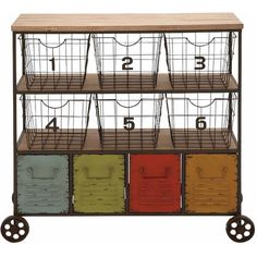 Keep games and toys organized in the nursery or stow yarn and fabric in the craft room with this bold industrial cart, featuring numbered bins and weathered ...