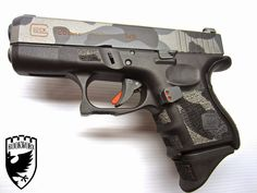A RookWorx & Rebel Road Custom Glock 26 Rebel Road Custom Cerakote Camo -Stippled Grip Panels -Double Undercut trigger -40 Degree Beveled Slide www.Rook... - Rook Worx - Google+