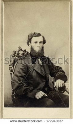 CIRCA 1864 - A vintage Cartes de visite photo of a gentleman. The man is sitting with one arm on the arm of the chair. A photo from the Civil War Victorian era. A digital copy can be purchased at the above web link.