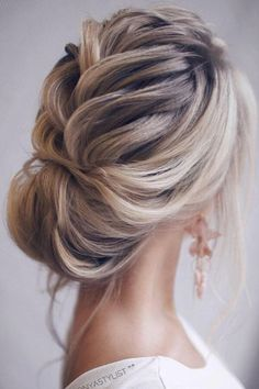 A messy updo with volume in the right places should be your go-to look for holiday parties