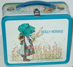 How about a vintage lunch box ? What this is my childhood I have this with my holly hobby collection now