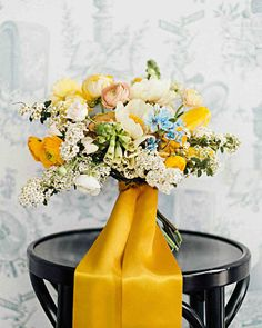 A Colorful Brooklyn Wedding with Lots of Patterns | Martha Stewart Weddings - The bride's bouquet had seasonal blooms like foxgloves, peonies, spirea, and ranunculus, held together with a bright-yellow ribbon.