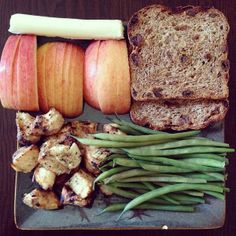 Lunch is: Ezekiel cinnamon raisin bread, mozzarella, apple, grilled chicken and green beans