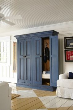 Entryway coat storage cabinet to die for! Think I need one of these in John's office hallway.