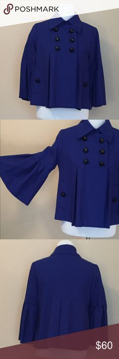 Anthropologie Bow and Arrow Pea Coat This adorable Anthropologie Bow and Arrow royal blue pea coat features wide pleated at the elbow sleeves and black buttons. It is wool with an acetate lining! It is so sweet! j Anthropologie Jackets & Coats Pea Coats