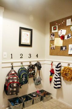 great mudroom ideas: automatic light that turns off/on, basket of socks, house numbers on wall for kids backpacks, bulletin board, hooks all the way around the room, striped ceiling