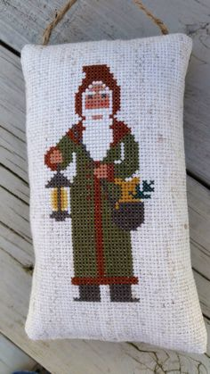 A personal favorite from my Etsy shop https://www.etsy.com/listing/210266272/old-world-santa-ornament-cross-stitch