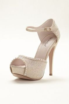 """Glamorous and eye-catchingMary Jane platformis sure to romance any heart!   Peep toe platform Mary Jane sandalfeatures avariety of sparkling rhinestones.  Adjustable strap adds comfort and ensures a secure fit.  Heel measures 4 1/2"""". Platform measures 1 1/2"""".  Manmade cushioned sole.  Fully lined. Imported by Coloriffics."""