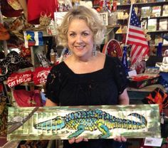 So pleased to welcome Susan to the Louisiana Marketshops at the 115 family. She paints colorful Louisiana creatures on old shutters!