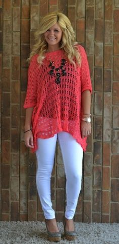 knit shaw top with white skinny jeans and a big loud necklace.  I also LOVE that she is wearing white pants & is NOT a stick figure! Yay for Curves ;)