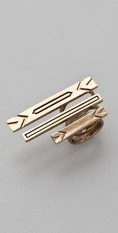 14k gold-plated stacking rings features engraved chevrons and bars.