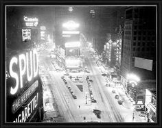 Times Square is covered in a white blanket during snowstorm. Print by New York Daily News Archive at Photos.com