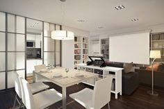 Apartamento de 45 m2 separa cozinha com porta de correr e dá sensação de espaço maior