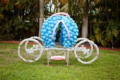 This is amazing Cinderella carriage decorated with blue balloons for a Princess-themed party!