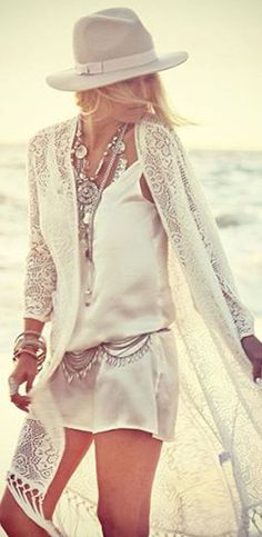 Sexy boho chic crochet embellished cover up with chunky layered modern hippie necklaces & gypsy coin belt. For the BEST Bohemian fashion style FOLLOW https://www.pinterest.com/happygolicky/the-best-boho-chic-fashion-bohemian-jewelry-gypsy- now