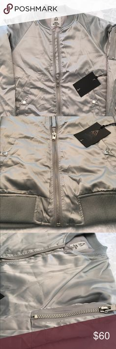 """❤️Host Pick❤️NWT silver satin bomber $80 @ UrbanO Rizzo-approved satin bomber jacket exclusively for UO by UNIF. In a slouchy fit flanked with snap-button pockets and trimmed with stretchy ribbed knit hems all over. Finished with a mini zip pocket at the arm. - Polyester - Dry clean - Imported - Model in Silver is 5'11"""" and wearing size Small - Chest:  - Length: Urban Outfitters Jackets & Coats Bomber & Varsity"""