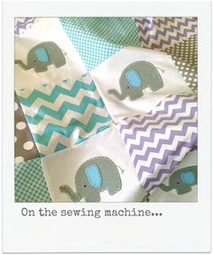 On the sewing machine... lilac and aqua elephant quilt