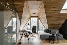 Located in the Polish town of Sopot, this tiny attic apartment Okrezna Attic was designed in 2016 by Raca Architekci. You've probably seen lots of attic apartments but Attic Playroom, Attic Loft, Attic Rooms, Attic Bathroom, Attic Office, Attic Bed, Attic Library, Garage Attic, Attic Ladder