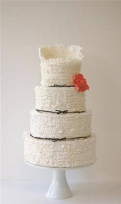 Wedding Cakes: White Ruffled Cake with an Orange Flower Accent