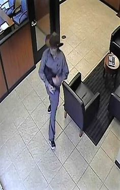 The FBI is looking for the public's help identifying a gun-toting bank bandit who on Thursday threatened Chase Bank tellers in Houston with a hoax explosive device.