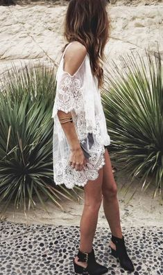 'Cold shoulder' white lace dress with black ankle boots