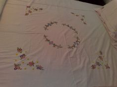 Hand embroidered bedsheet . Flowers filled with satin stitch