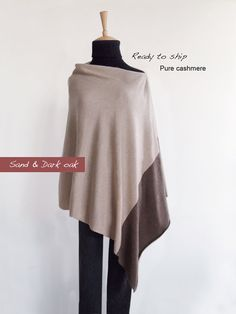"""READY TO SHIP. This beautiful and elegant duo color poncho is very soft and smooth. Very versatile and perfect cover up for between seasons. It is so easy to wear, simply slip over your head and put the seam on your shoulder so that the poncho hangs slightly off-center. Ideal for travel it fits and folds easily into your handbag.   Yarn: Pure cashmere.  Color: Sand + dark oak.  Size (+/-):  Poncho: When fully open  (L) 68cm / 26.7"""" (W) 78cm / 30.7"""" Cashmere Poncho, Cashmere Color, Knitwear, Cover Up, Tunic Tops, Pure Products, Elegant, My Style, Fabric"""