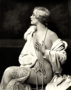Ziegfeld girl circa the 1920's... I love the placement of the pearls!!