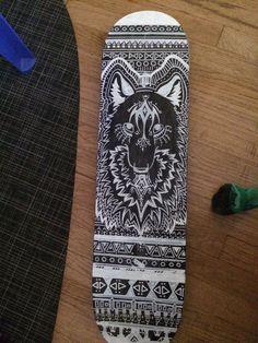 Wolf drawing on skateboard