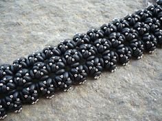 Black bracelet with twin duos