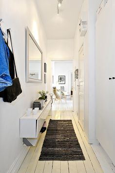 Small hallway, but there's room for storage - I guess it's Ikea CD storage