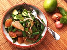 This salad has bittersweet pomelo in a spicy dressing with snappy green beans and zucchini #recipe #thaifood