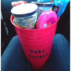 Puke bucket ( for pregnant friend) Included gum to settle stomach Ice cream for late night cravings Apple juice and goldfish to Settle upset stomach Cute pink scented trash bags Mnms for hard times And a super cute travel friendly bucket for those nasty morning sickness moments