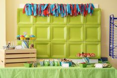 Cute / Cheap Decoration for Birthday Party - plates on the wall behind the table - i need to be more creative!!  :-)