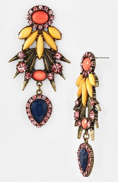In love with these pendant drop earrings. Adore the mix of bold colors on this vintage setting.